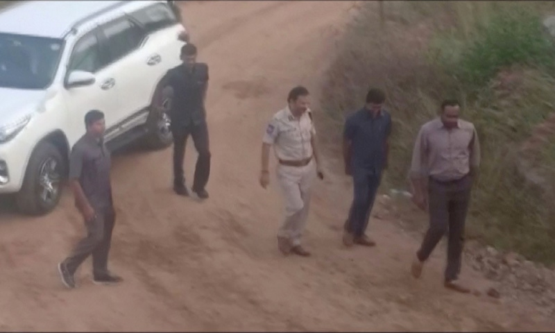 Still frame taken from a December 6 video shows Cyberabad Police Commissioner V.C. Sajjanar and other police arriving at a spot where police shot dead four men suspected of raping a veterinary doctor, in Hyderabad, Telangana, India. — ANI via Reuters