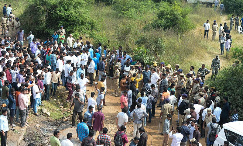 Police block an area near the site where they shot dead four detained gang-rape and murder suspects in Shadnagar on December 6. — AFP