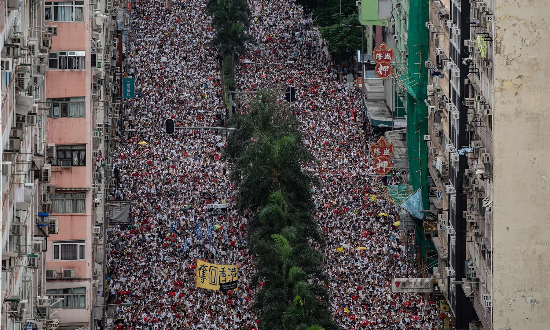 Protesters march during a rally against a controversial extradition law proposal in Hong Kong on June 9. — AFP