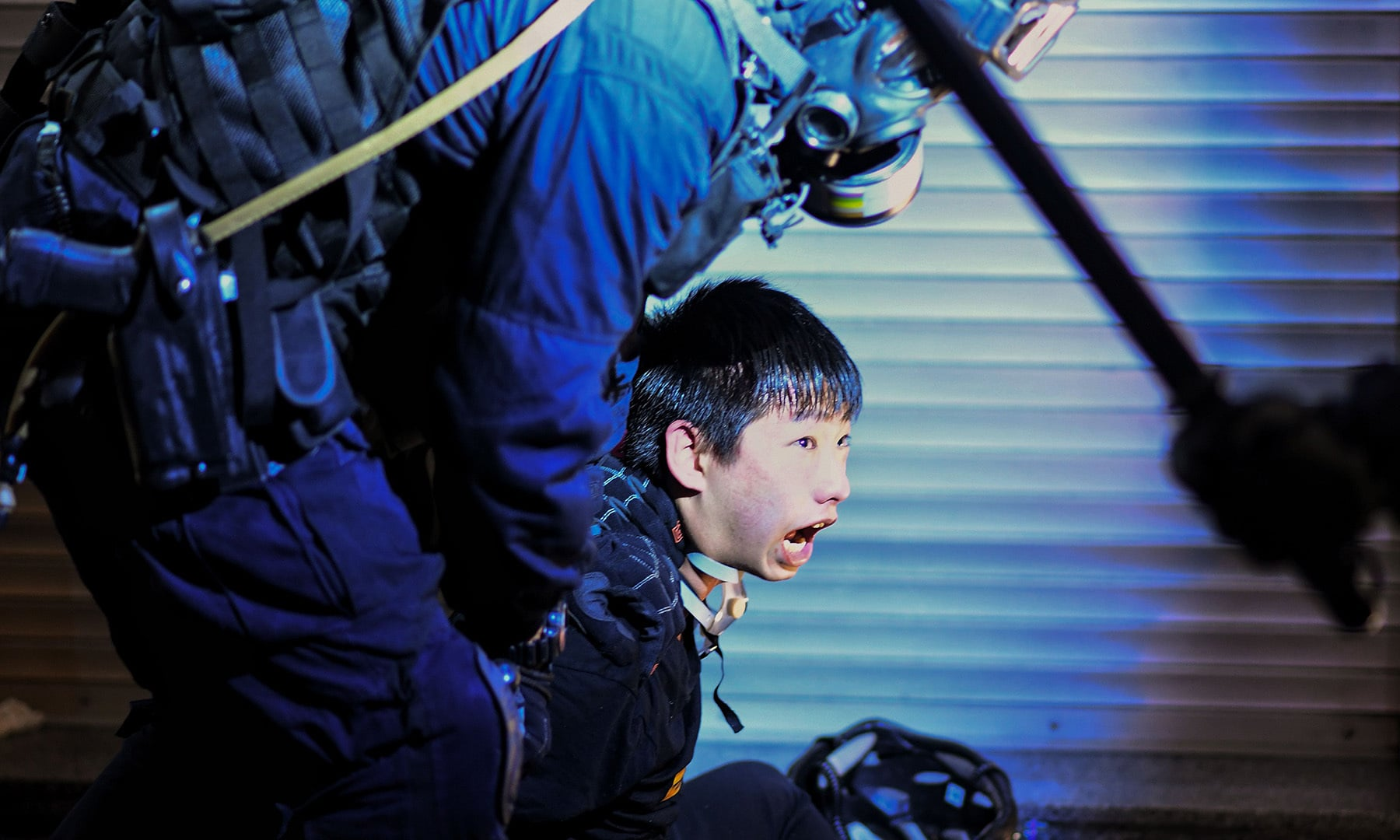 A pro-democracy protester is held by police outside Tsim Sha Tsui Police station during a demonstration against the controversial extradition bill in Hong Kong on August 11. — AFP