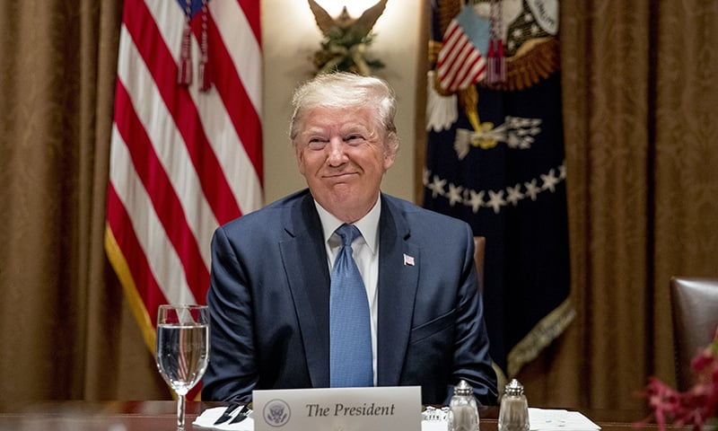 President Donald Trump smiles during a luncheon with members of the United Nations Security Council in the Cabinet Room at the White House in Washington on Thursday, Dec. 5, 2019. — AP