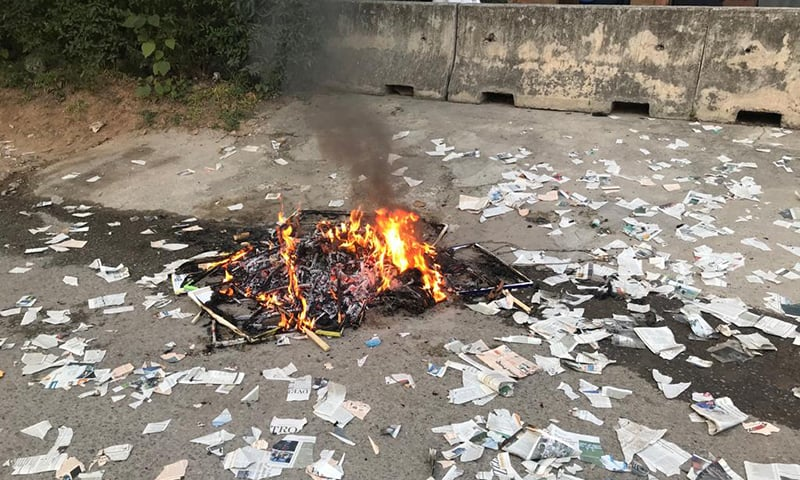 Protesters burnt copies of Dawn newspaper outside  the Islamabad office on Friday. — Photo courtesy Naveed Siddiqui