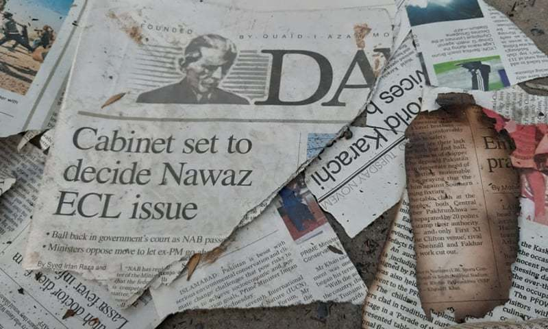 Burnt copies of Dawn newspaper. — Photo by Tanveer Shahzad