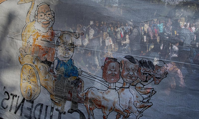 An artwork is displayed during a protest against the Citizenship Amendment Bill by Indian students and activists in Gauhati, India, Friday. — AP