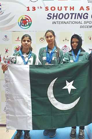 KATHMANDU: Pakistan's women shooters pose after clinching bronze medal in the air pistol 10m event at the South Asian Games on Friday.