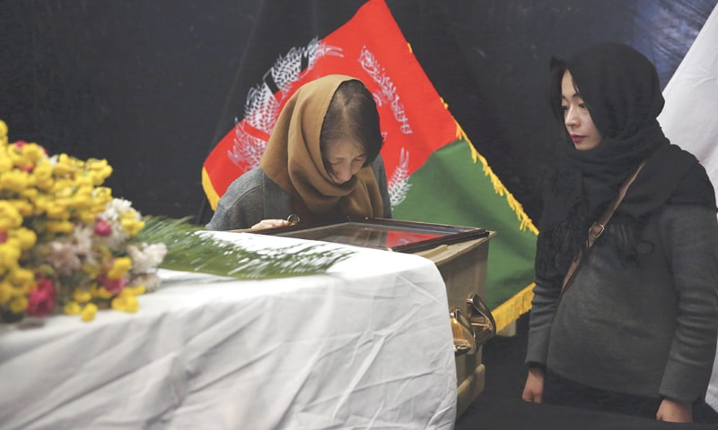 Kabul: The wife and daughter of slain Japanese physician Tetsu Nakamura stand beside his coffin after they arrived here to pay their tribute to Nakamura at the Afghan military hospital on Friday.—AP