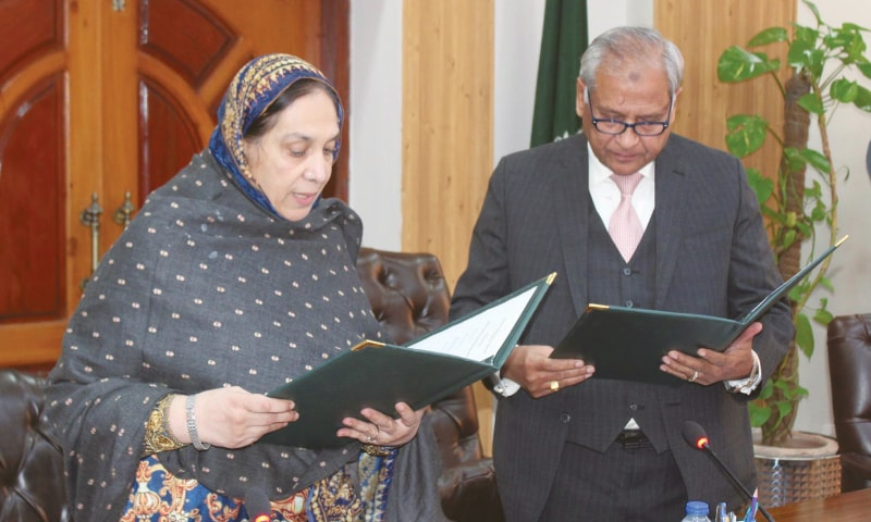ISLAMABAD: Member of the Election Commission of Pakistan retired Justice Irshad Qaiser administers the oath to retired Justice Altaf Ibrahim Qureshi as the acting chief election commissioner on Friday.—Online