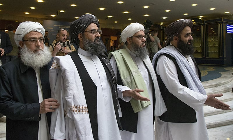 In this May 28 file photo, Mullah Abdul Ghani Baradar, the Taliban group's top political leader, second left, arrives with other members of the Taliban delegation for talks in Moscow, Russia. — AP