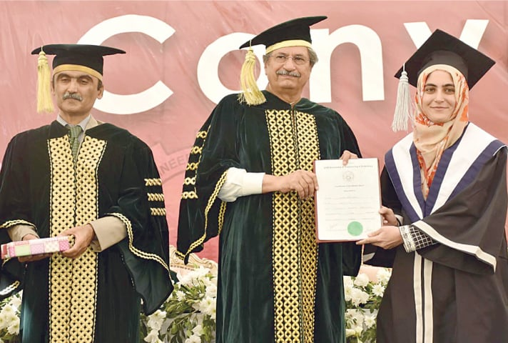 Federal minister Shafqat Mahmood gives away certificates and gold medals to position-holders at the NED  convocation on Saturday.—INP