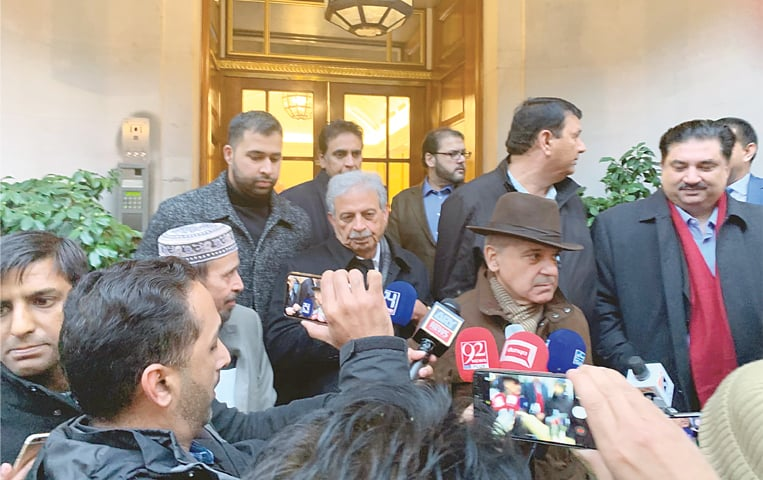 LONDON: PML-N president Shahbaz Sharif, Nawaz Sharif's son Hussein Nawaz and party leaders pictured on the occasion of meeting with the former prime minister on Saturday.—Photo by writer