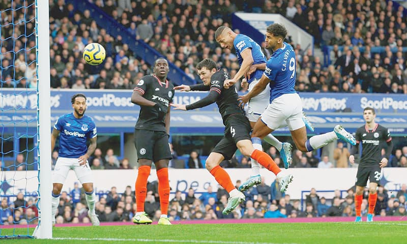LIVERPOOL: Everton's Richarlison (second R) heads to score during the Premier League match against Chelsea at Goodison Park on Saturday.—Reuters