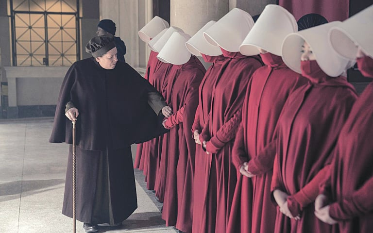 Aunt Lydia (Ann Dowd) inspects a row of Handmaids under her charge | Still from the television adaptation of The Handmaid's Tale