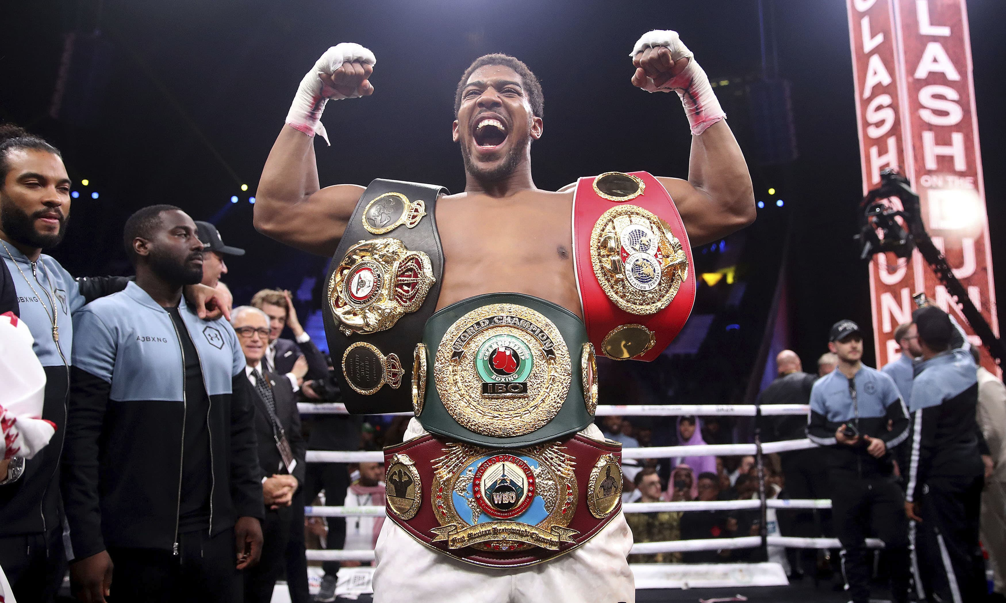 Britain's Anthony Joshua celebrates after beating  Andy Ruiz Jr on points to win their World Heavyweight Championship at the Diriyah Arena, Riyadh on Sunday Dec 8. —AP