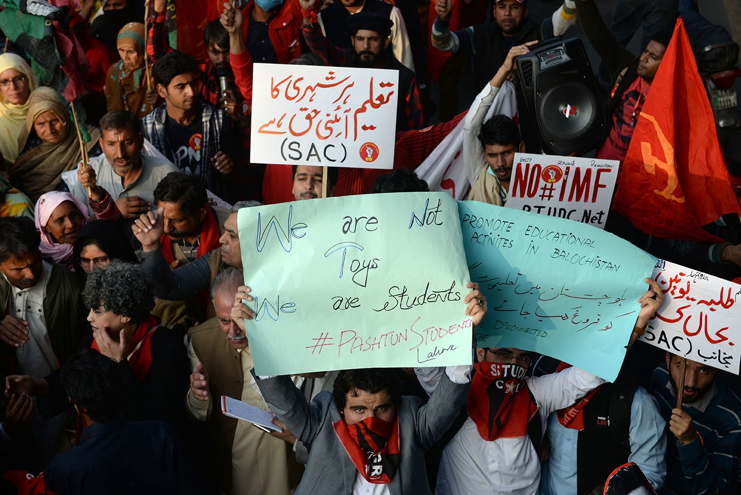 A Pashtun student holds up a sign at the march in Lahore | Murtaza Ali/White Star