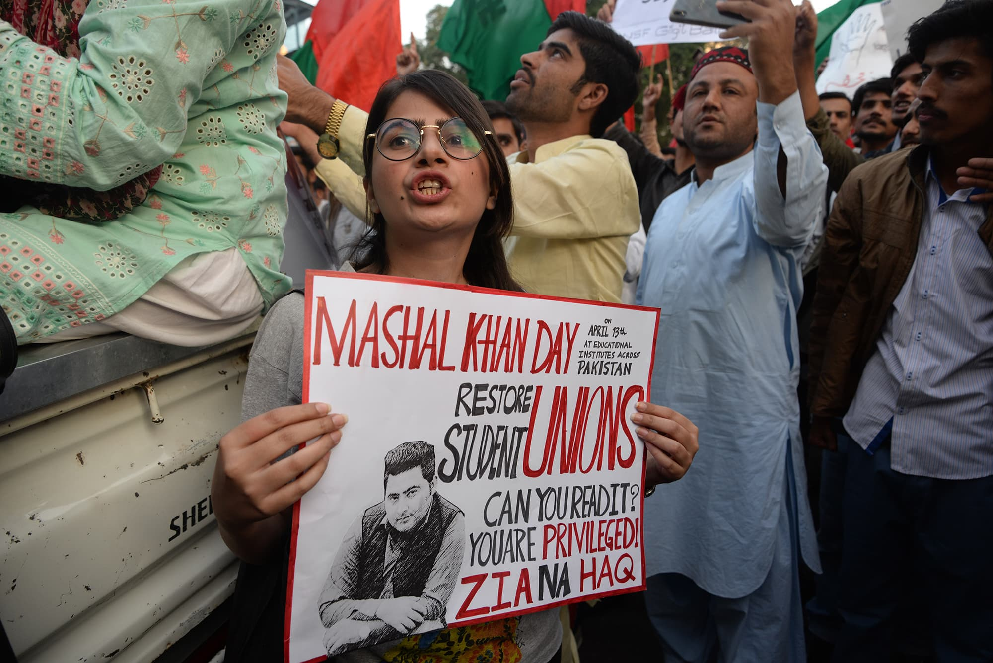 A marcher holds a placard with a photo of Mashal Khan in Karachi | Shakil Adil/White Star
