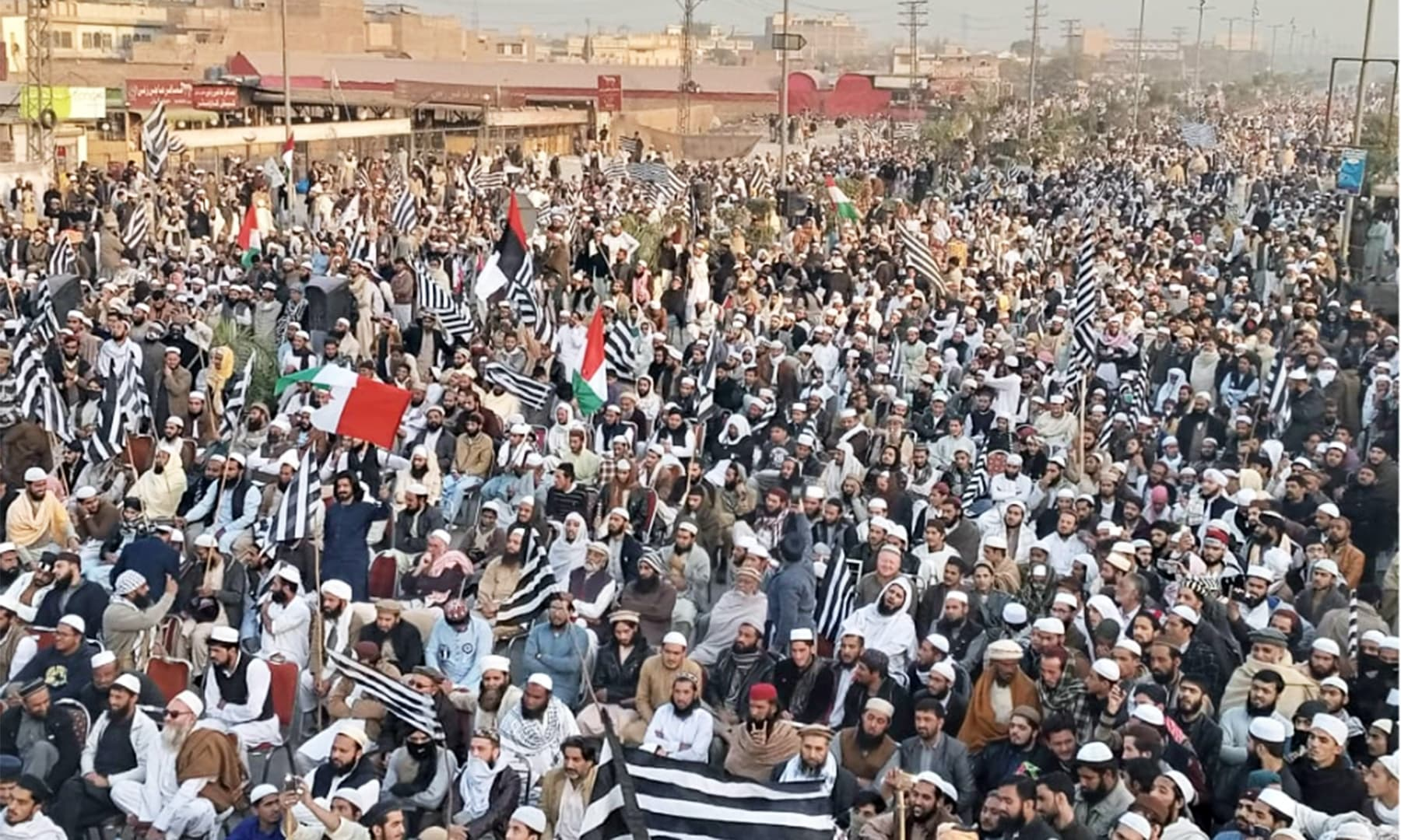 A large number of supporters gathered to hear the maulana speak in Peshawar on Sunday. — Photo by author