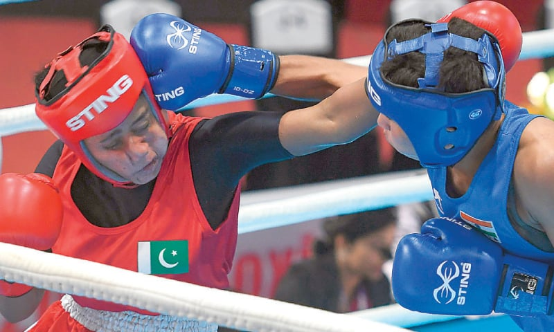 KATHMANDU: Pakistan's Mehreen (L) fights with India's Sonia Lather during their women's featherweight semi-final at the South Asian Games on Sunday. — AFP