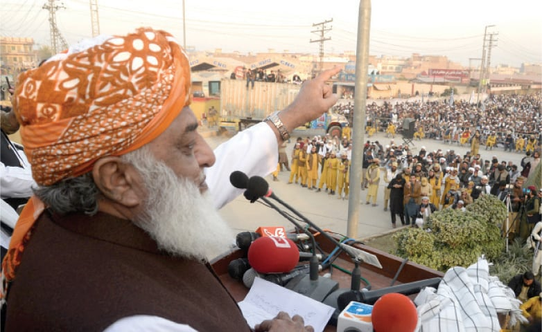 Maulana Fazlur Rehman addresses a public meeting on Ring Road, Peshawar, on Sunday. — White Star