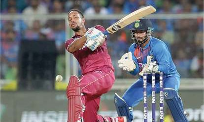 West Indies' Lendl Simmons plays a shot during the second Twenty20 International against India on Sunday. — AP