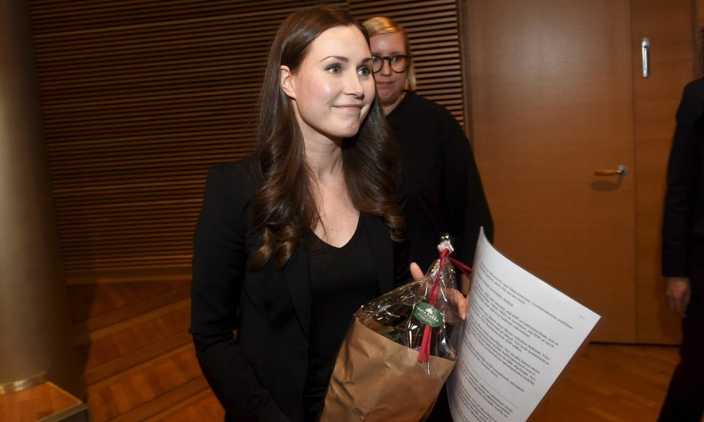 The candidate for the next Prime Minister of Finland, Sanna Marin, smiles after winning the SDP's Prime Minister candidate vote against Antti Lindtman, in Helsinki, Finland, on Dec 8. — AP