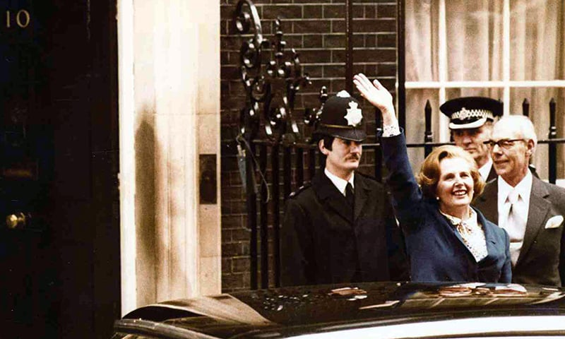 In this May 4, 1979 photo, Britain's Conservative Party leader Margaret Thatcher waves to wellwishers as she arrives at 10 Downing Street, London with her husband Denis, right. — AP