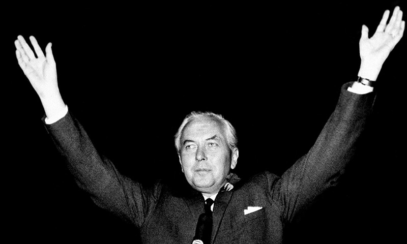 In this October 15, 1964 photo, Britain's Labour Party leader Harold Wilson raises his hands after retaining his parliamentary seat in Huyton, England and leading his party to victory. — AP