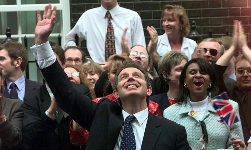 In this Friday, May 2, 1997 photo, Britain's new Prime Minister Tony Blair, waves to wellwishers in Downing Street, London. — AP