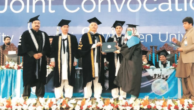 Chief Minister Mahmood Khan awards degree to a graduate during the convocation in Swabi on Monday. — Dawn