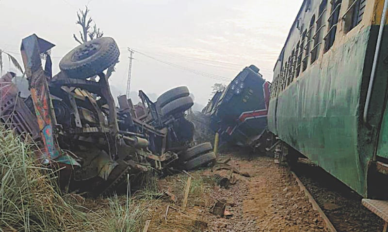 Sargodha: Derailed Sargodha Express carriages and the damaged truck after the collision on Monday.—White Star