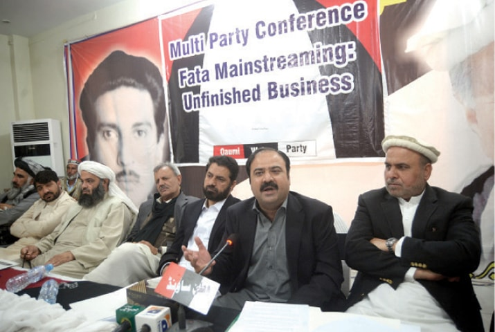Qaumi Watan Party provincial chief Sikandar Hayat Sherpao speaks at the multiparty conference in Peshawar on Monday. — White Star