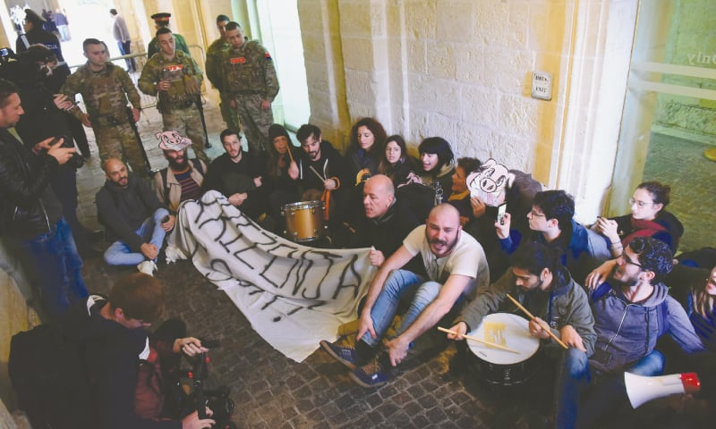 Activists sit after having barged into Maltese Prime Minister Joseph Muscat's office, calling for his resignation in the wake of recent findings in the murder case of anti-corruption journalist Daphne Caruana Galizia two years ago. — Reuters