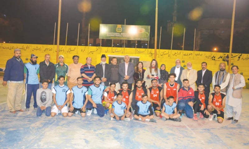KARACHI: Chief guest Syeda Itrat Hassan and other KBBA and PTF officials are seen with the players at the inauguration of the fourth Essa Lab Basketball Cup on Sunday night.