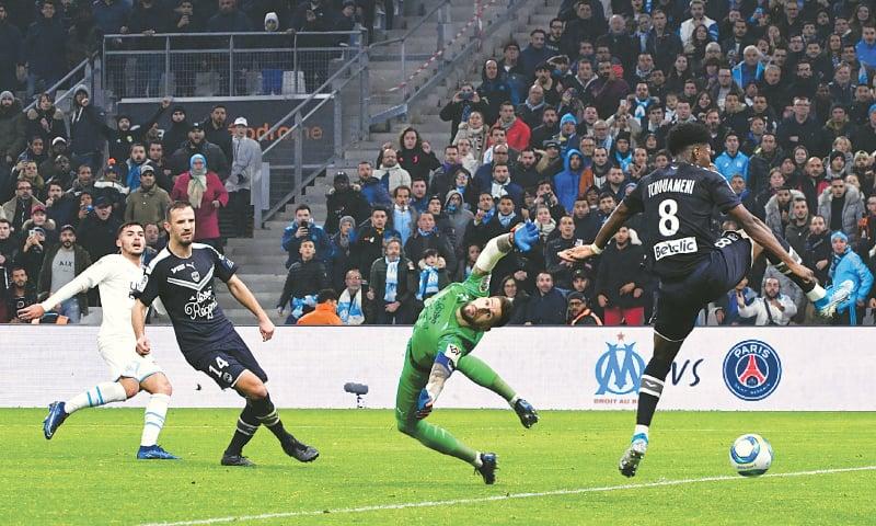 MARSEILLE: Olympique de Marseille's Nemanja Radonjic (L) scores past Girondins de Bordeaux goalkeeper Benoit Costil during their Ligue 1 match at the Velodrome Stadium.—AFP