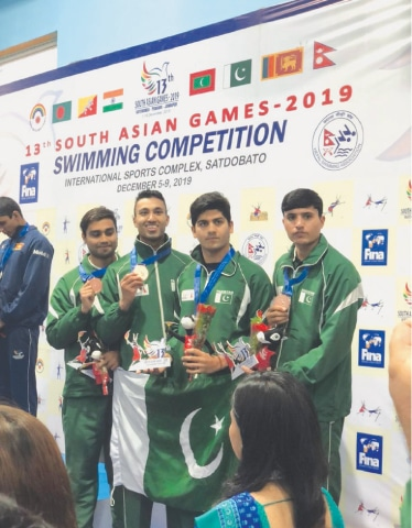 KATHMANDU: Swimmers from Pakistan's 4x100m relay team pose with their bronze medals.