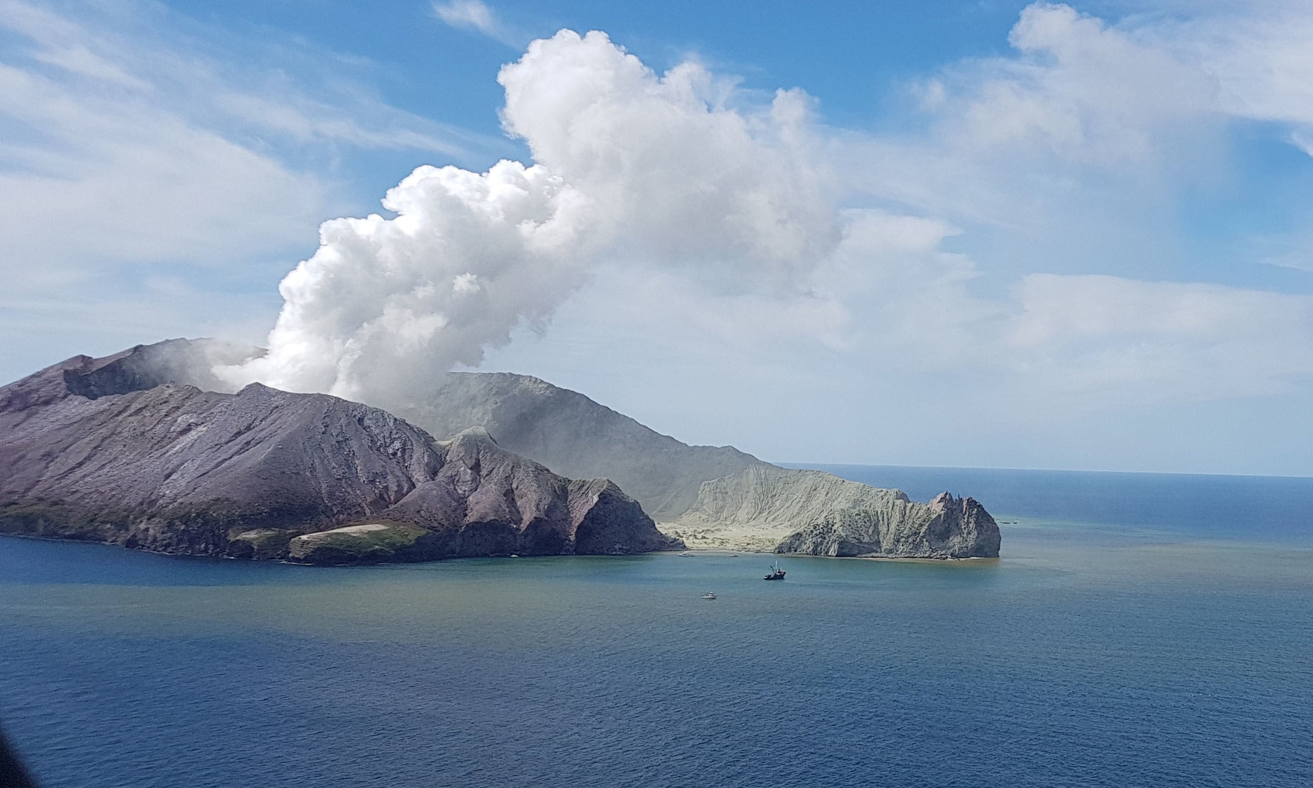 Many people are questioning why tourists were still allowed on White Island after seismic monitoring experts raised the volcano's alert level last month. — AP