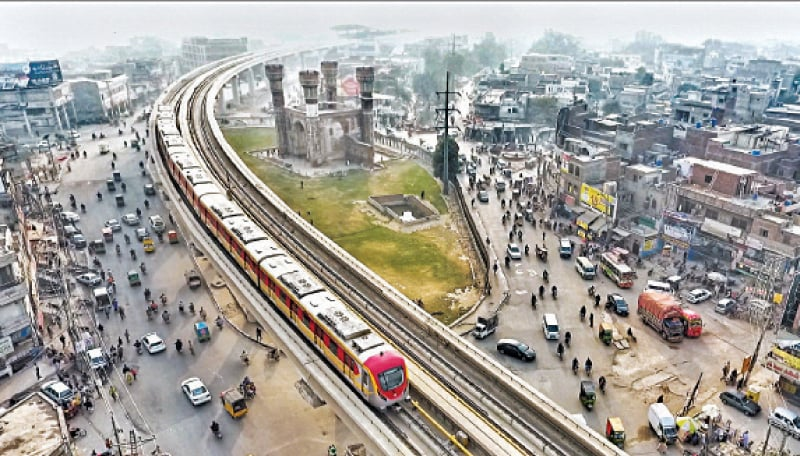 An aerial view of the Orange Line train passing near Chauburji during its test run. — White Star / Aun Jafri