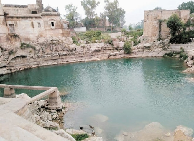 The Katas Raj pond in Chakwal is a pilgrimage site for Hindus. — Dawn