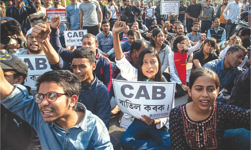 GUWAHATI: Holding placards, protesters raise slogans against the Citizenship Amendment Bill during a demonstration here on Tuesday.—AP