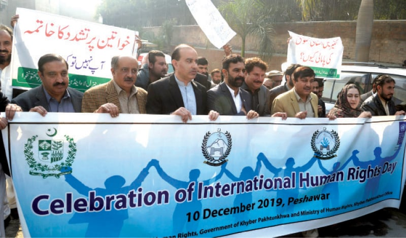Provincial Law Minister Sultan Mohammad leads a walk held in Peshawar on Tuesday to mark the International Human Rights Day. — White Star