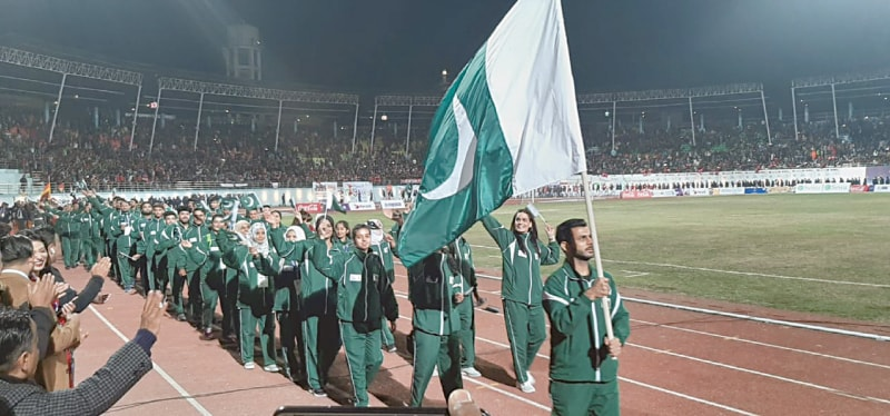 KATHMANDU: Pakistan's squash player Tayyab Aslam carries the national flag as he leads the country's contingent during the closing ceremony of the 13th South Asian Games on Tuesday.