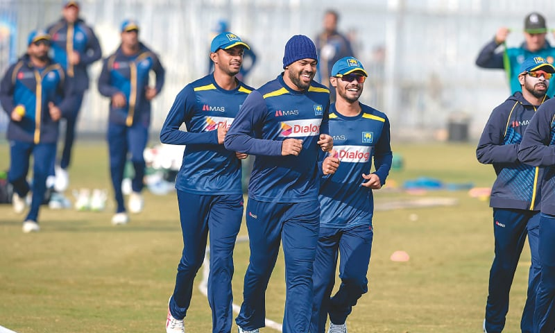 SRI LANKAN cricketers warm up before their practice session at the Pindi Cricket Stadium on Tuesday ahead of the first Test against Pakistan.—AFP