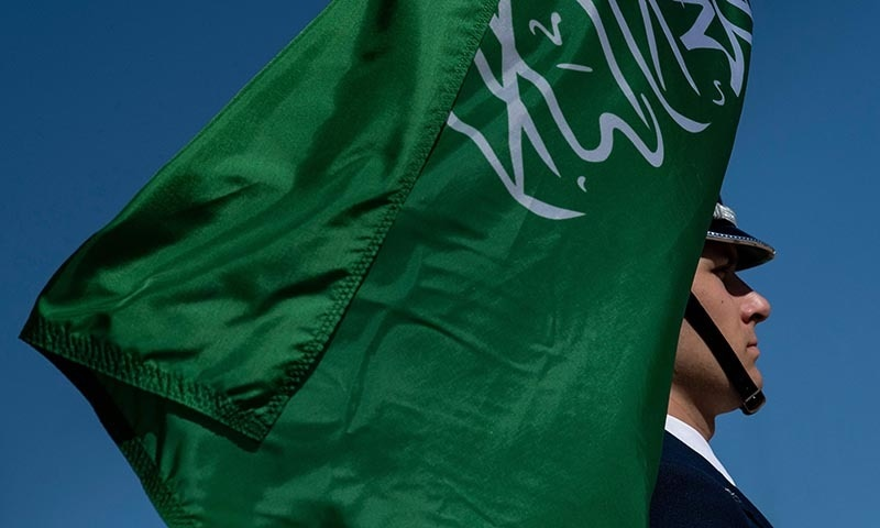 In this file photo taken on August 29, a color guard holds Saudi Arabia's flag while waiting for Saudi Vice Minister of Defense Prince Khalid bin Salman arrival for an honor cordon at the Pentagon in Washington, DC. — AFP