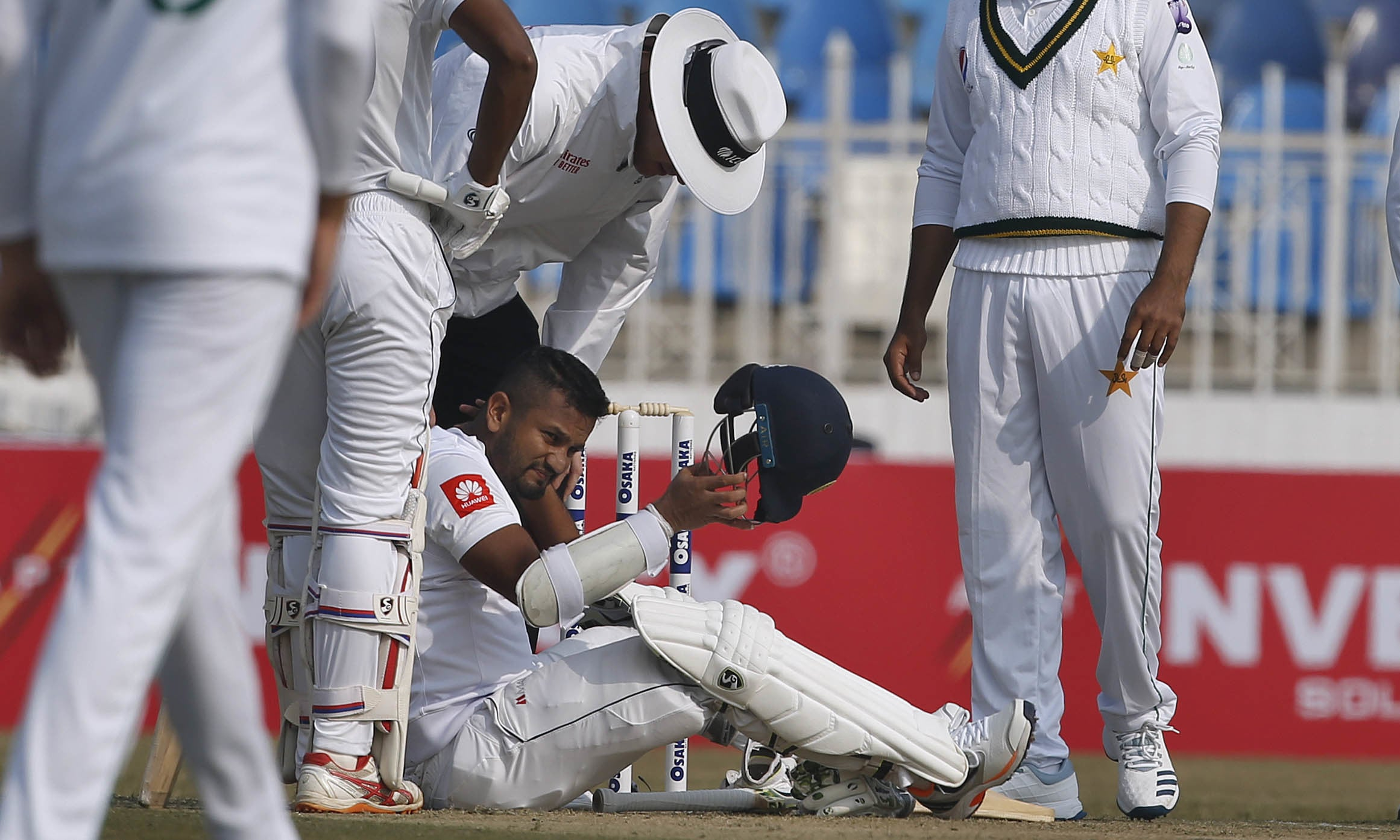 Sri Lankan batsman Dimuth Karunaratne falls down after a delivery of Pakistani pacer Naseem Shah hitting his neck during the first Test match between Pakistan and Sri Lanka in Rawalpindi on Wednesday Dec 11. — AP