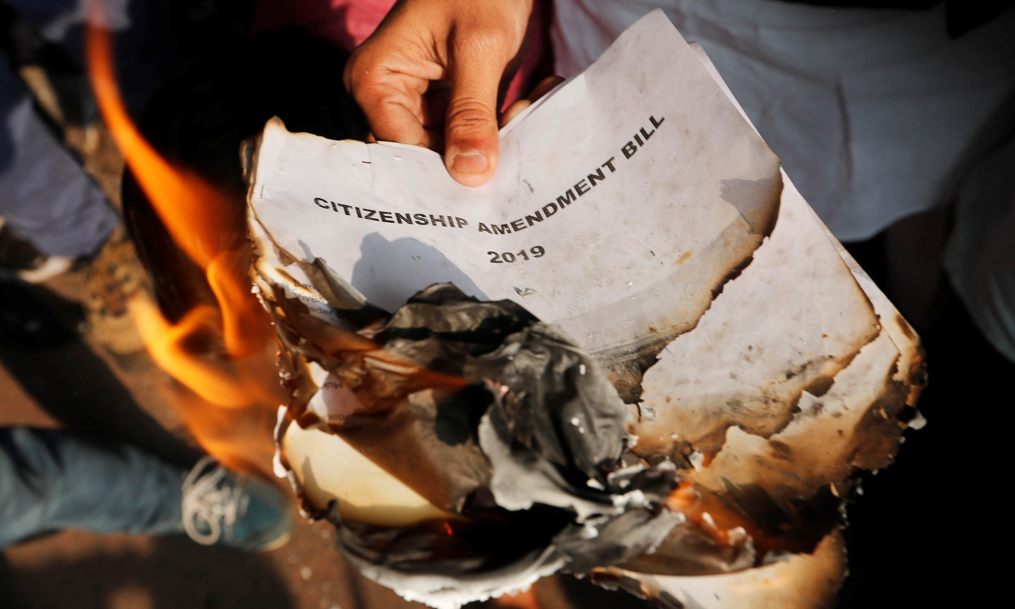 Demonstrators burn copies of the Citizenship Amendment Bill, a bill that seeks to give citizenship to religious minorities persecuted in neighbouring Muslim countries, during a protest in New Delhi, India on Dec 11. — Reuters