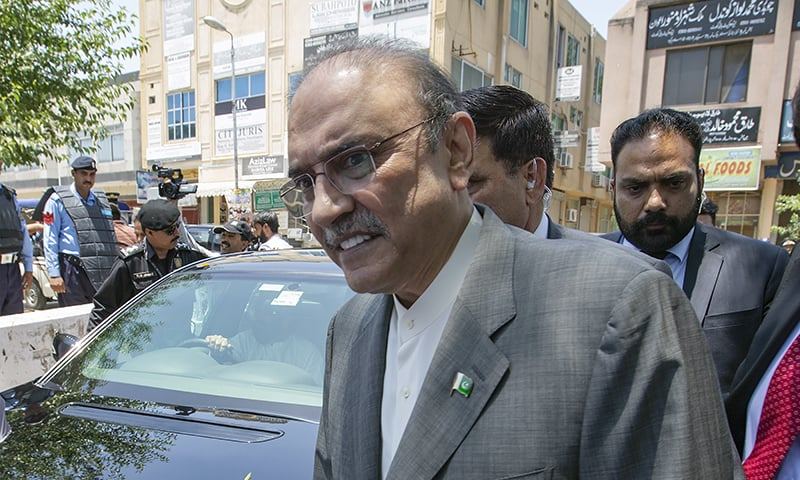 FILE - In this June 10, 2019, file photo, former Pakistani president and currently a lawmaker in Parliament and leader of Pakistan People's party, Asif Ali Zardari, center, leaves the High Court building, in Islamabad, Pakistan. A Pakistani court has ordered the release of ailing Zardari on bail on medical grounds so that he can seek medical treatment at a hospital of his choice in the country. (AP Photo/B.K. Bangash, File) — Copyright 2019 The Associated Press. All rights reserved.