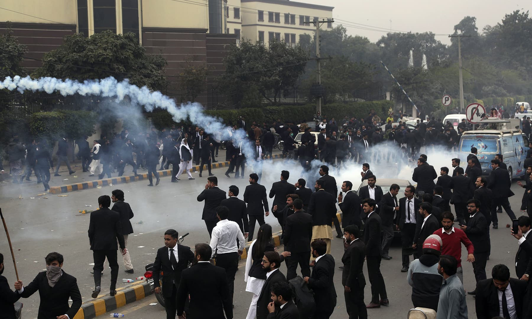 Police use tear gas shell to disperse angry lawyers during a clash in Lahore. — AP