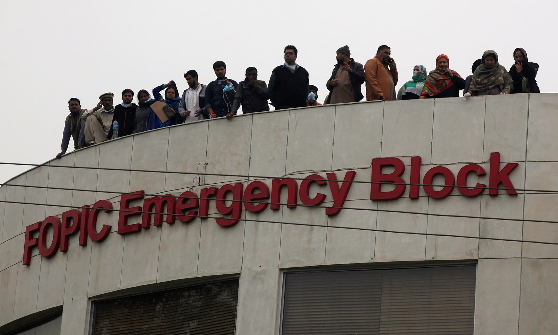 People gather on the rooftop of the emergency block after a group of lawyers stormed the PIC. — Reuters