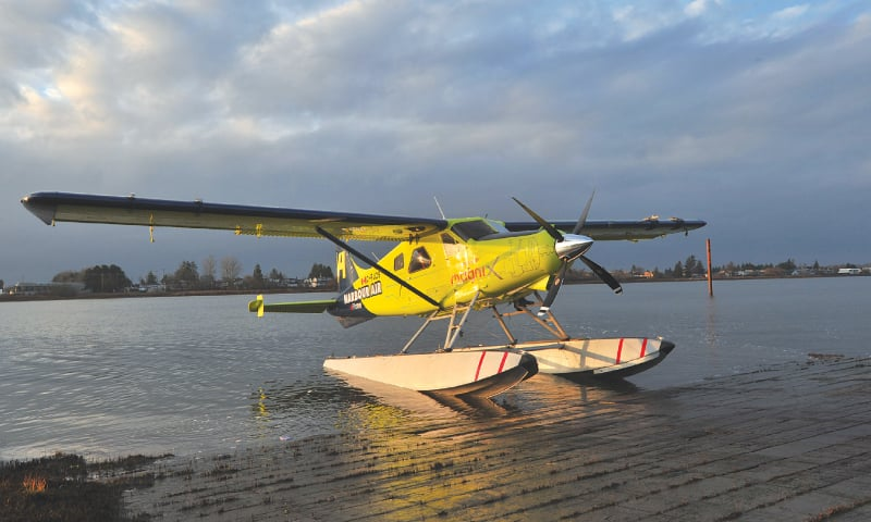 Richmond (British Columbia, Canada): Harbour Air Pilot and CEO Greg McDougall flies the world's first all-electric, zero-emission commercial aircraft during a test flight on the Fraser River.—AFP