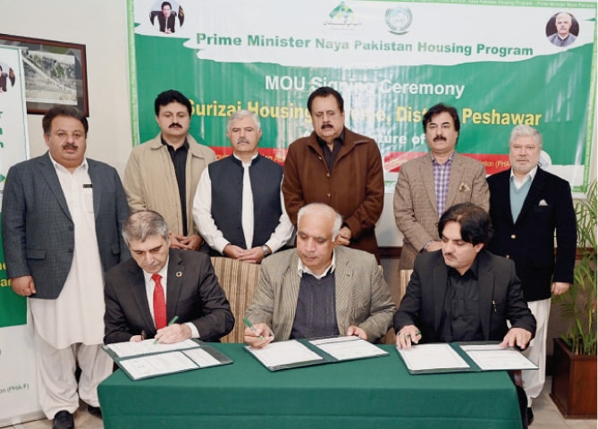 Chief Minister Mahmood Khan witnesses signing ceremony of the memorandum of understanding of Prime Minister's Naya Pakistan Housing Programme in Peshawar on Wednesday.