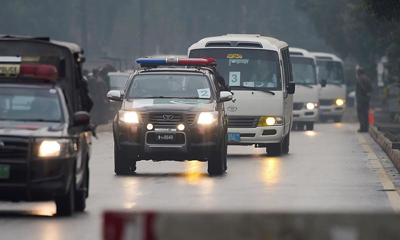 Security personnel escort a convoy transporting Pakistan's and Sri Lankan cricketers to the Pindi Cricket Stadium before the start of the first day of the first Test cricket match between Pakistan and Sri Lanka in Rawalpindi on December 11. — AFP